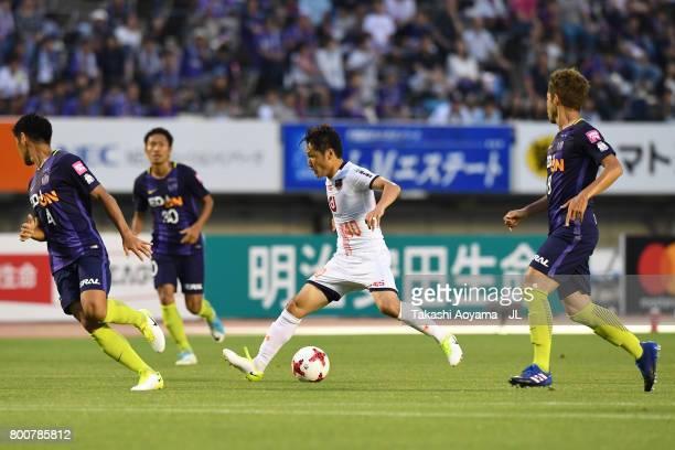 Akimi Barada of Omiya Ardija controls the ball under pressure of Sanfrecce Hiroshima defense during the JLeague J1 match between Sanfrecce Hiroshima...