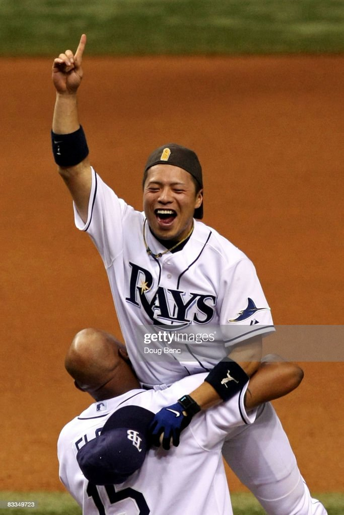 Akinori Iwamura and Cliff Floyd of the Tampa Bay Rays celebrate after defeating the Boston Red Sox in game seven of the American League Championship...