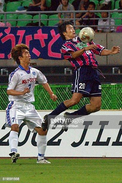 Akinori Nishizawa of Cerezo Osaka controls the ball under pressure of An Sunjin of Mito HollyHock during the JLeague second division match between...