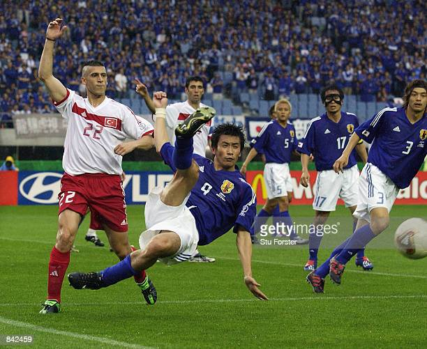 Akinori Nishizawa of Japan tries to make a perfect connection during the FIFA World Cup Finals 2002 Second Round match between Japan and Turkey...