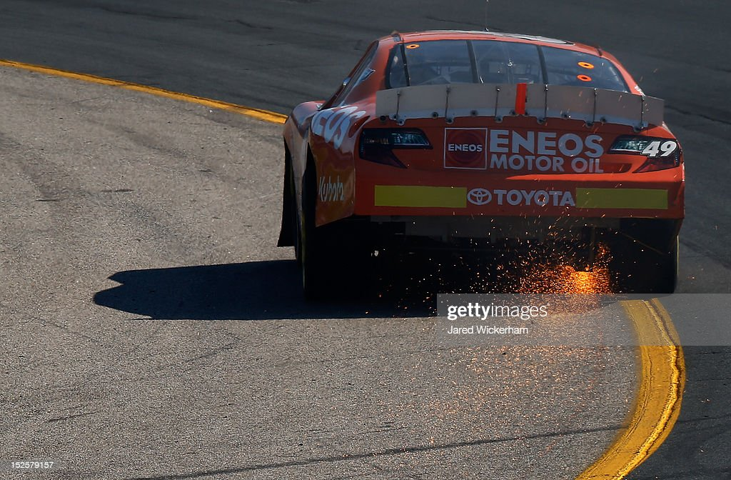 Akinori Ogata drives the #49 Eneos Motor Oil Toyota as sparks fly after an incident in the NASCAR K&N Pro Series East G-Oil 100 at New Hampshire Motor Speedway on September 22, 2012 in Loudon, New Hampshire.