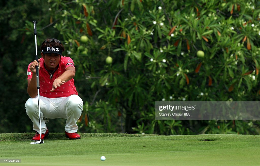 Akinori Tani of Japan lines for a putt on the 7th hole during Day Two of The Open Qualifying Series Thailand 2014 at the Amata Spring Golf Club on March 7, 2014 in Bangkok, Thailand.