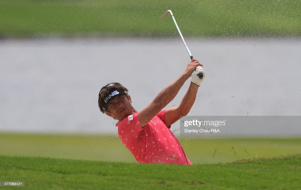 Akinori Tani of Japan plays a bunker shot on the 18th hole during Day Two of The Open Qualifying Series Thailand 2014 at the Amata Spring Golf Club on March 7, 2014 in Bangkok, Thailand.