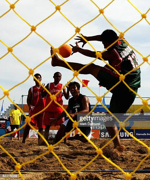 Akio Fujii of Japan shoots at goal with Lolaroh Alfrid of Indonesia keeping during the Mens Beach Handball on day seven of the 2008 Asian Beach Games...