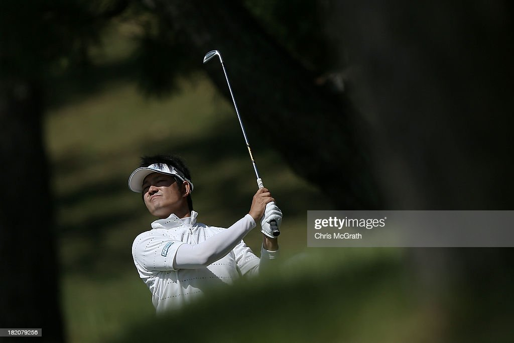 Akio Sadakata of Japan plays his second shot out of the trees on the fourth hole during day three of the Panasonic Japan Open at Ibaraki Golf Club on September 28, 2013 in Ibaraki, Japan.