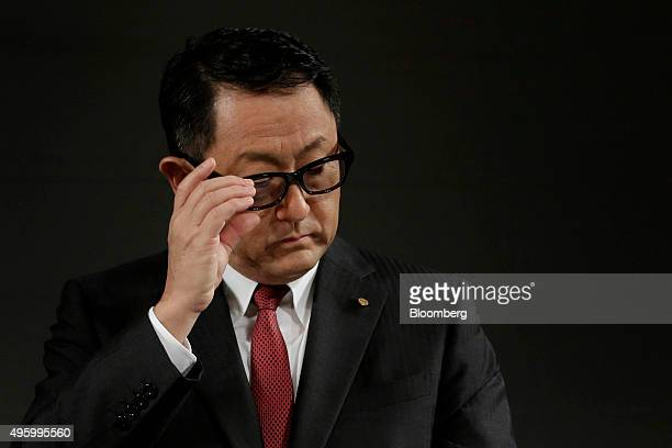 Akio Toyoda president of Toyota Motor Corp adjusts his glasses during a news conference in Tokyo Japan on Friday Nov 6 2015 Toyota's operations at...
