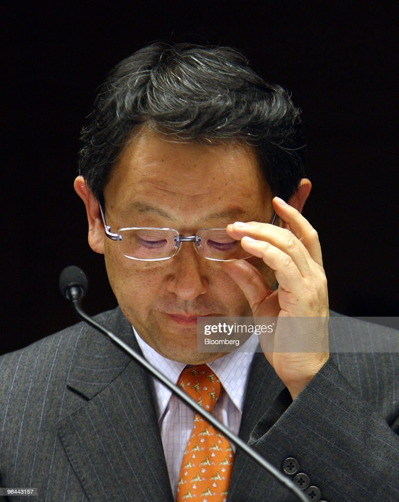 Akio Toyoda, president of Toyota Motor Corp., adjusts his glasses during a news conference in Nagoya, Japan, on Friday, Feb. 5, 2010. Toyoda apologized for the company's growing recall crisis in his first public appearance since the company halted U.S. sales and production of its best-selling models last month. Photographer: Tomohiro Ohsumi/Bloomberg via Getty Images