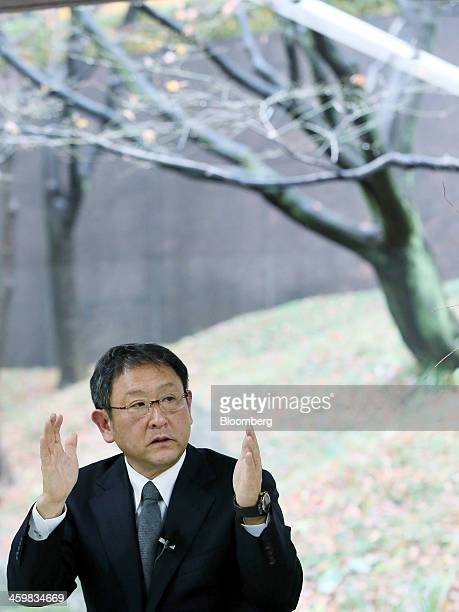 Akio Toyoda president of Toyota Motor Corp and chairman of the Japan Automobile Manufacturers Association gestures as he speaks during a group...