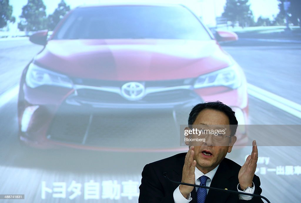 <a gi-track='captionPersonalityLinkClicked' href=/galleries/search?phrase=Akio+Toyoda&family=editorial&specificpeople=2334399 ng-click='$event.stopPropagation()'>Akio Toyoda</a>, president of Toyota Motor Corp., gestures as he speaks in front of a screen displaying an image of the company's Camry sedan during a news conference in Tokyo, Japan, on Thursday, May 8, 2014. Toyota, the world's largest carmaker, forecast profit will fall from last year's record as demand slumps in Japan, competition intensifies in the U.S. and the yen is no longer the boon it used to be. Photographer: Tomohiro Ohsumi/Bloomberg via Getty Images