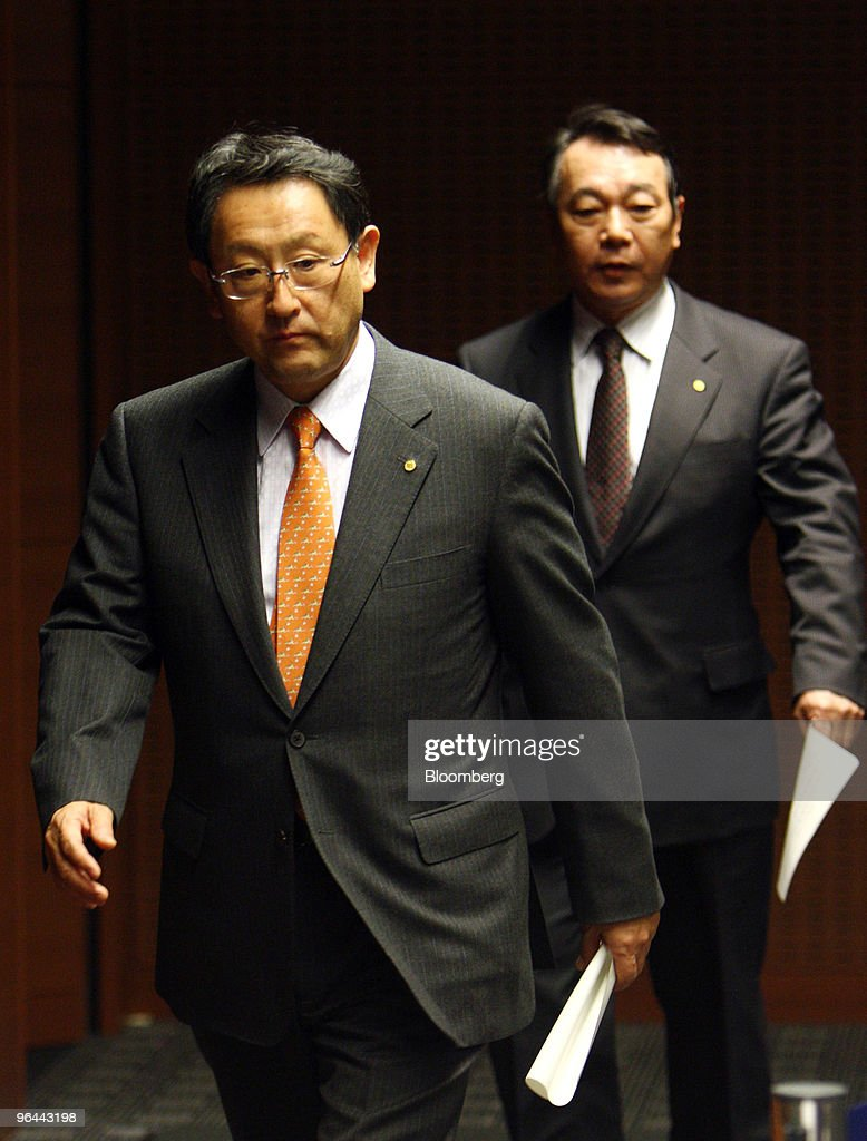 Akio Toyoda, president of Toyota Motor Corp., left, and Shinichi Sasaki, executive vice president of the company, arrive for a news conference in Nagoya, Japan, on Friday, Feb. 5, 2010. Toyoda apologized for the company's growing recall crisis in his first public appearance since the company halted U.S. sales and production of its best-selling models last month. Photographer: Tomohiro Ohsumi/Bloomberg via Getty Images