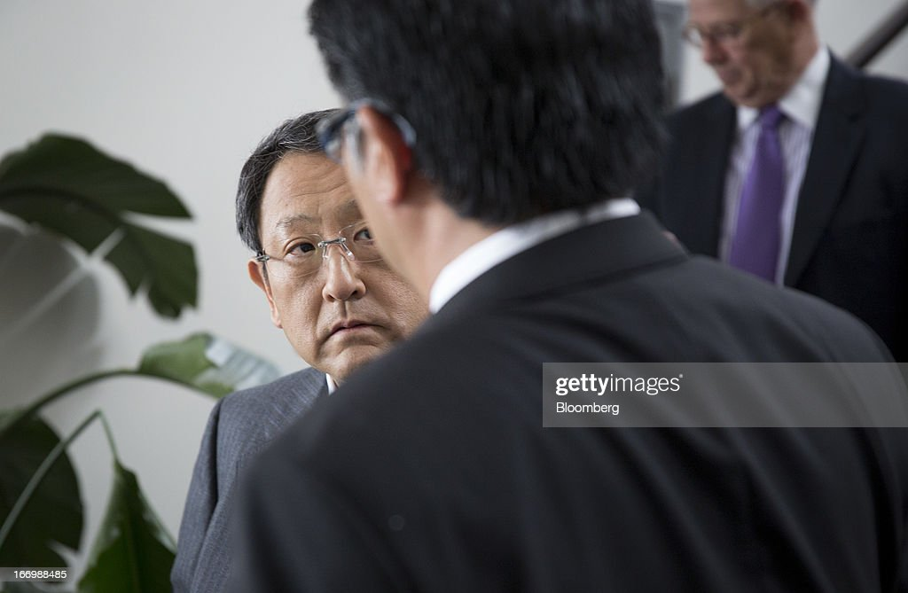 Akio Toyoda, president of Toyota Motor Corp., left, pauses before a news conference in New York, U.S., on Friday, April 19, 2013. in New York, U.S., on Friday, April 19, 2013. Toyota Motor Corp. plans to build Lexus ES 350 sedans in Kentucky, the first U.S. production for its luxury brand, Toyoda pushes to localize output in the automaker's biggest markets. Photographer: Scott Eells/Bloomberg via Getty Images