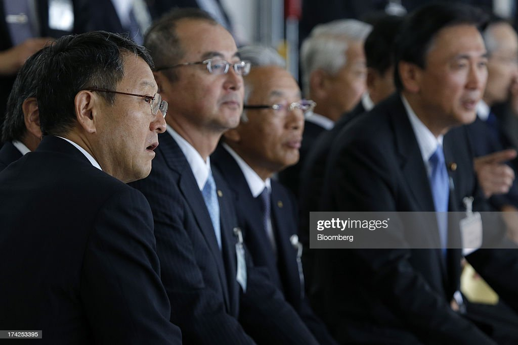 <a gi-track='captionPersonalityLinkClicked' href=/galleries/search?phrase=Akio+Toyoda&family=editorial&specificpeople=2334399 ng-click='$event.stopPropagation()'>Akio Toyoda</a>, president of Toyota Motor Corp., left, watches a training demonstration with other attendees during the completion ceremony for the company's Tajimi service center in Tajimi, Gifu Prefecture, Japan, on Monday, July 22, 2013. Toyota is the world's largest car maker. Photographer: Kiyoshi Ota/Bloomberg via Getty Images