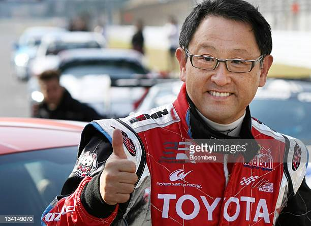 Akio Toyoda president of Toyota Motor Corp poses during the unveiling of the company's 86 sports coupe at Fuji Speedway in Oyama Town Shizuoka...