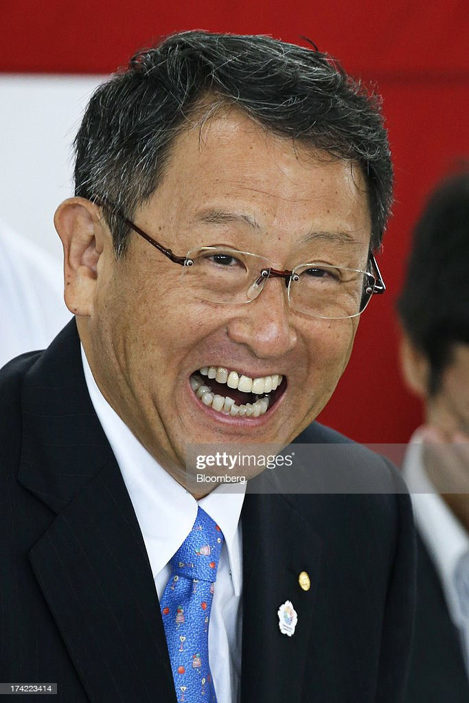 <a gi-track='captionPersonalityLinkClicked' href=/galleries/search?phrase=Akio+Toyoda&family=editorial&specificpeople=2334399 ng-click='$event.stopPropagation()'>Akio Toyoda</a>, president of Toyota Motor Corp., reacts during the completion ceremony of the company's Tajimi service center in Tajimi, Gifu Prefecture, Japan, on Monday, July 22, 2013. Toyota is the world's largest car maker. Photographer: Kiyoshi Ota/Bloomberg via Getty Images