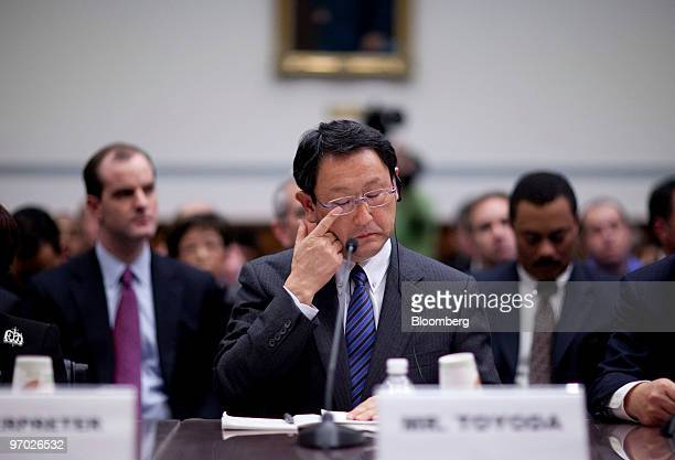 Akio Toyoda president of Toyota Motor Corp rubs his eye during a House Oversight and Government Reform Committee hearing in Washington DC US on...