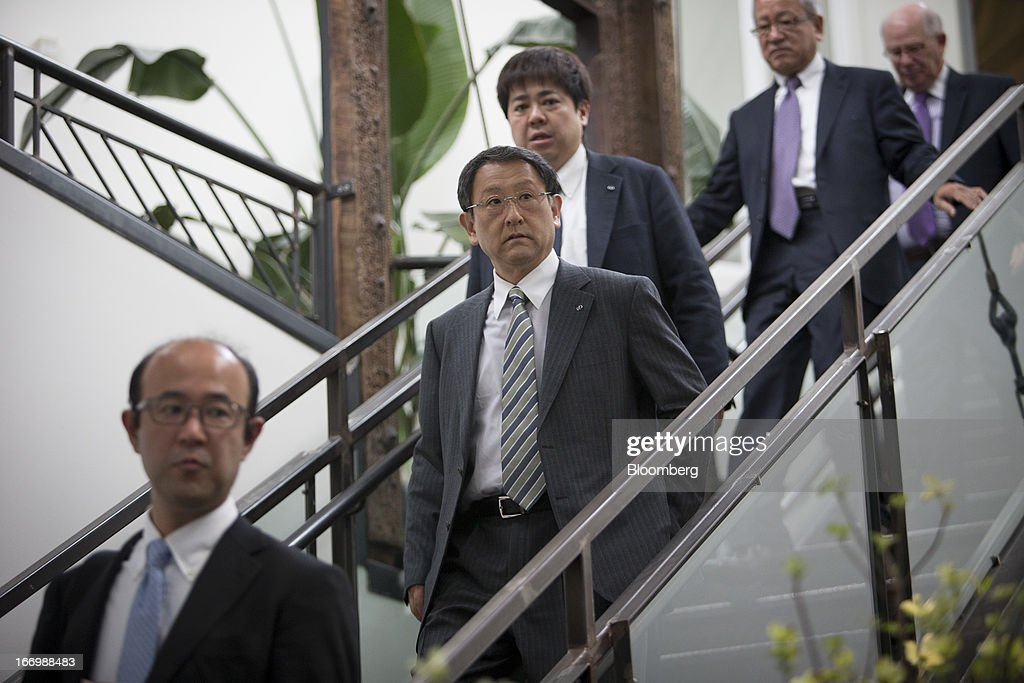 Akio Toyoda, president of Toyota Motor Corp., second from left, descends a staircase before a news conference in New York, U.S., on Friday, April 19, 2013. Toyota Motor Corp. plans to build Lexus ES 350 sedans in Kentucky, the first U.S. production for its luxury brand, Toyoda pushes to localize output in the automaker's biggest markets. Photographer: Scott Eells/Bloomberg via Getty Images