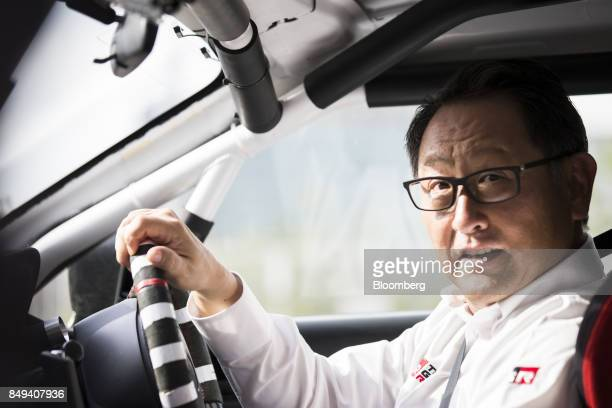 Akio Toyoda president of Toyota Motor Corp sits on the driver's seat of the Toyota 86 Morizo coupe after the unveiling of the 'GR' sports car series...
