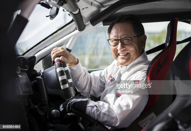 Akio Toyoda president of Toyota Motor Corp smiles as he sits in the driver's seat of the Toyota 86 Morizo coupe after the unveiling of 'GR' sports...