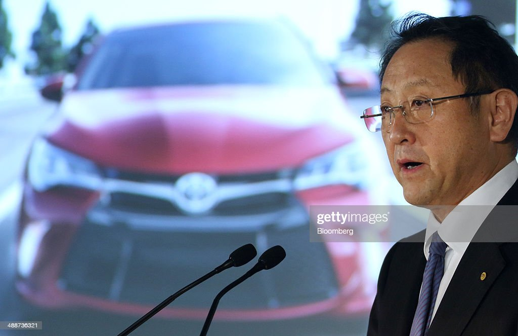 Akio Toyoda, president of Toyota Motor Corp., speaks in front of a screen displaying an image of the company's Camry sedan during a news conference in Tokyo, Japan, on Thursday, May 8, 2014. Toyota, the world's largest carmaker, forecast profit will fall from last year's record as demand slumps in Japan, competition intensifies in the U.S. and the yen is no longer the boon it used to be. Photographer: Tomohiro Ohsumi/Bloomberg via Getty Images