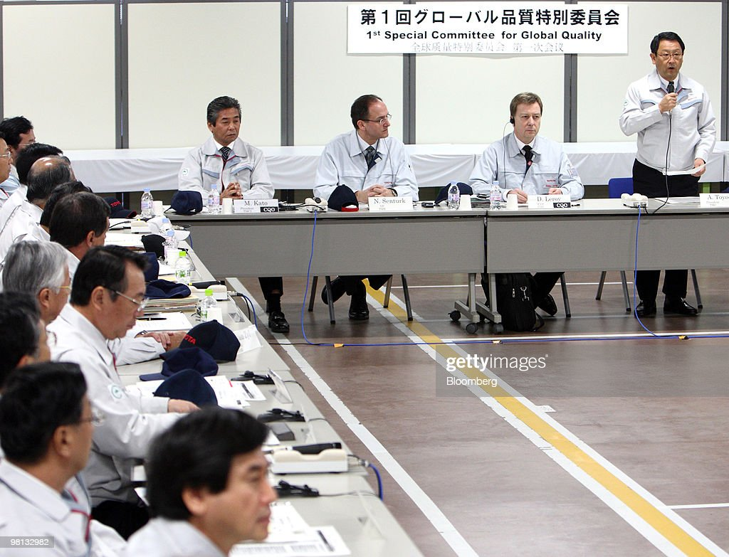 Akio Toyoda, president of Toyota motor Corp., standing right, speaks during the first meeting of the Special Committee for Global Quality in Toyota City, Japan, on Tuesday, March 30, 2010. Toyota Motor Corp.'s accelerator flaws and electronic vehicle controls will be examined by NASA as the U.S. expands its probe into incidents linked to at least 51 deaths. Photographer: Tomohiro Ohsumi/Bloomberg via Getty Images
