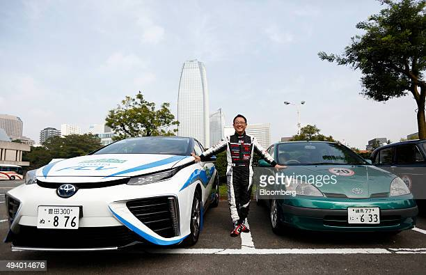 Akio Toyoda president of Toyota Motor Corp stands between the company's Mirai fuelcell powered vehicle left and a first generation Prius hybrid...