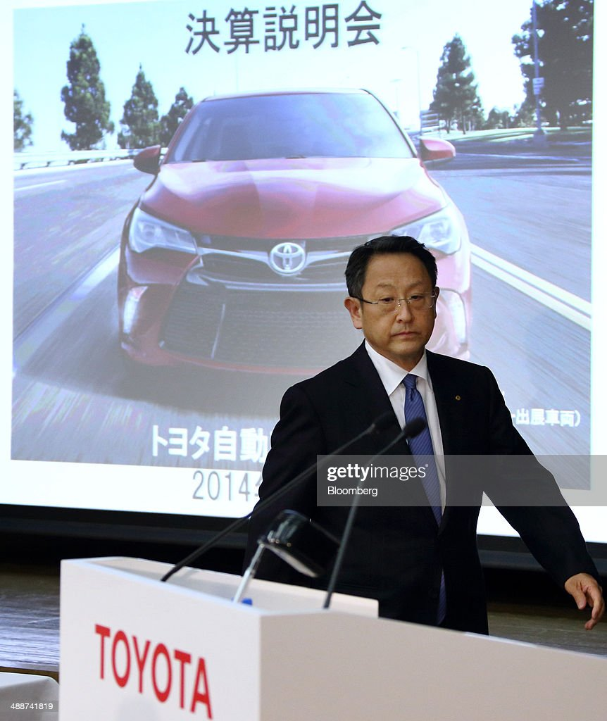 <a gi-track='captionPersonalityLinkClicked' href=/galleries/search?phrase=Akio+Toyoda&family=editorial&specificpeople=2334399 ng-click='$event.stopPropagation()'>Akio Toyoda</a>, president of Toyota Motor Corp., walks past a screen displaying an image of the company's Camry sedan as he arrives for a news conference in Tokyo, Japan, on Thursday, May 8, 2014. Toyota, the world's largest carmaker, forecast profit will fall from last year's record as demand slumps in Japan, competition intensifies in the U.S. and the yen is no longer the boon it used to be. Photographer: Tomohiro Ohsumi/Bloomberg via Getty Images
