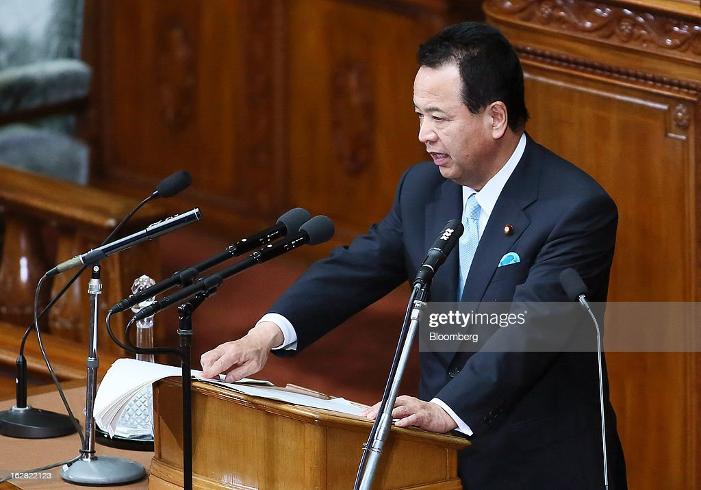 Akira Amari, Japan's economic revitalization minister, delivers his policy speech at the lower house of Parliament in Tokyo, Japan, on Thursday, Feb. 28, 2013. Amari expects the Bank of Japan to achieve their price target as soon as possible. Photographer: Haruyoshi Yamaguchi/Bloomberg via Getty Images