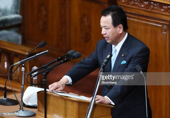 Akira Amari Japan's economic revitalization minister delivers his policy speech at the lower house of Parliament in Tokyo Japan on Thursday Feb 28...