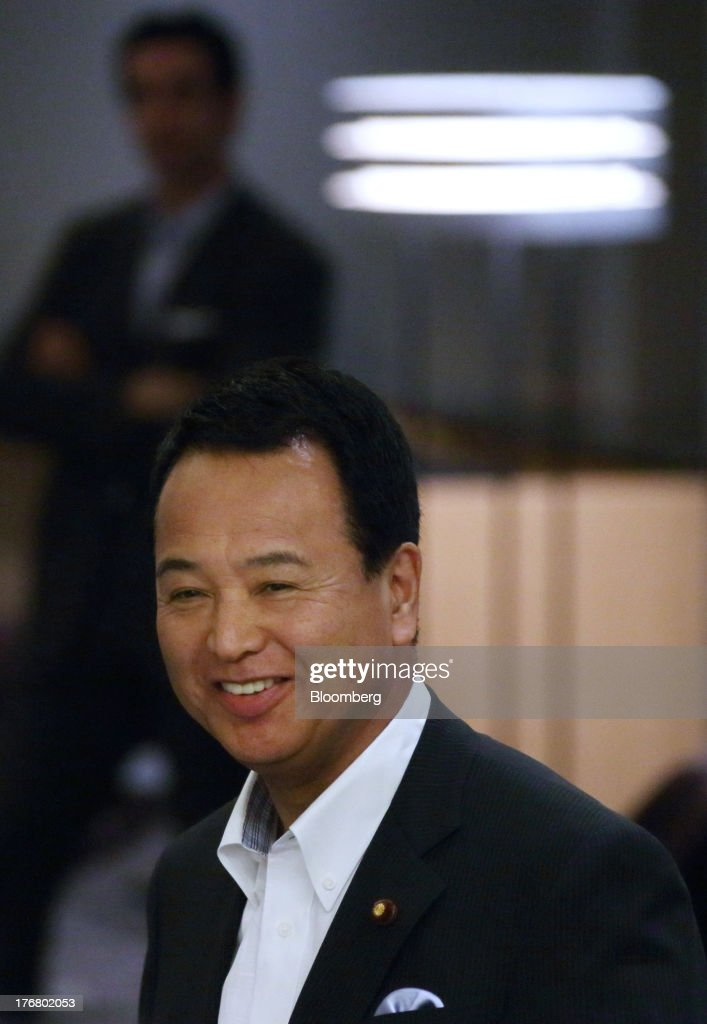<a gi-track='captionPersonalityLinkClicked' href=/galleries/search?phrase=Akira+Amari&family=editorial&specificpeople=3868034 ng-click='$event.stopPropagation()'>Akira Amari</a>, minister of state for economic and fiscal policy, smiles as he waits for the arrival of Michael Froman, U.S. trade representative, unseen, ahead of their meeting in Tokyo, Japan, on Monday, Aug. 19, 2013. The 11 nations participating in the Trans-Pacific Partnership (TPP) negotiations are seeking to create an economic zone with $26 trillion in annual output. Photographer: Tomohiro Ohsumi/Bloomberg via Getty Images