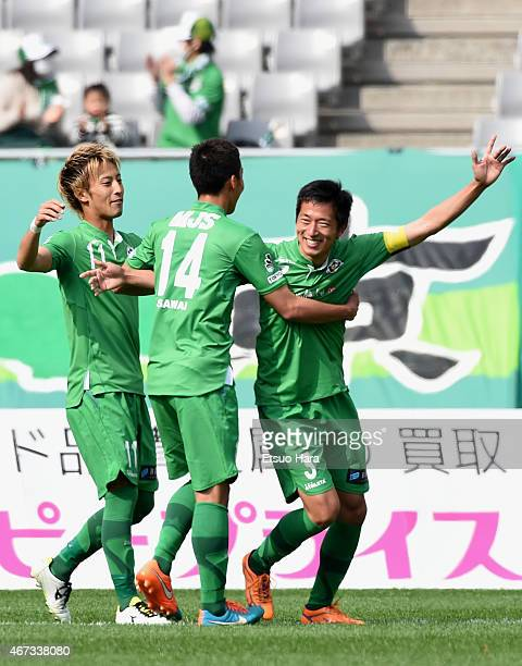Akira Ibayashi of Tokyo Verdy celebrates scoring his team's first goal with his team mates Shuto Minami and Naoto Sawai during the JLeague second...