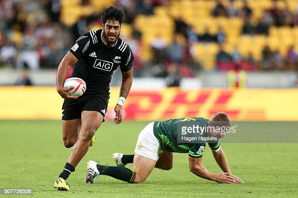 Akira Ioane of New Zealand beats the tackle of Kwagga Smith of South Africa during the 2016 Wellington Sevens cup final match between New Zealand and...