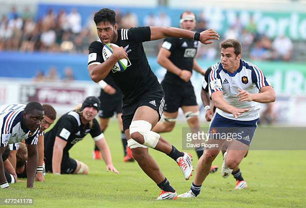 Akira Ioane of New Zealand holds off Damian Penaud to score a try during the World Rugby U20 Championship semi final match between France and New...