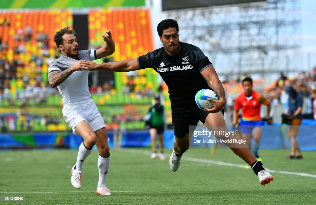 Akira Ioane of New Zeland holds off Terry Bouhraoua of France to score a try during the Men's Rugby Sevens placing match between New Zealand and France on day six of the Rio 2016 Olympic Games at Deodoro Stadium on August 11, 2016 in Rio de Janeiro, Brazil.
