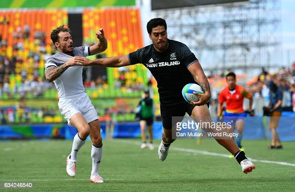 Akira Ioane of New Zeland holds off Terry Bouhraoua of France to score a try during the Men's Rugby Sevens placing match between New Zealand and...