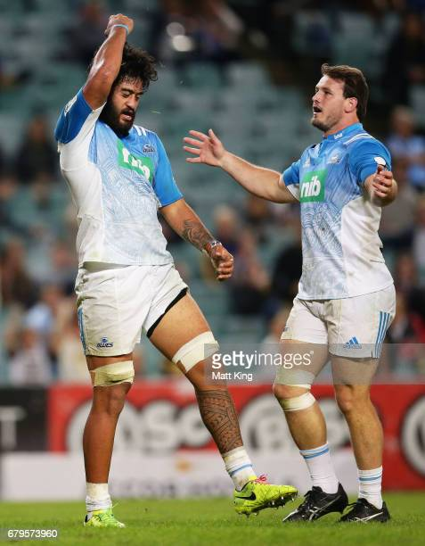 Akira Ioane of the Blues celebrates scoring a try during the round 11 Super Rugby match between the Waratahs and the Blues at Allianz Stadium on May...