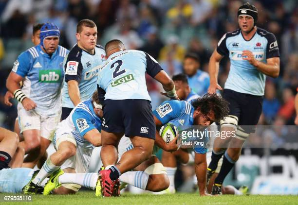 Akira Ioane of the Blues is tackled during the round 11 Super Rugby match between the Waratahs and the Blues at Allianz Stadium on May 6 2017 in...