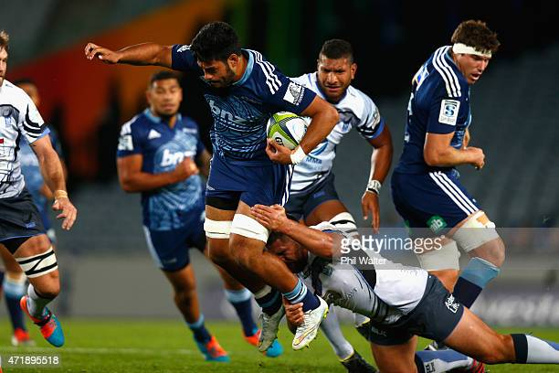 Akira Ioane of the Blues is tackled during the round 12 Super Rugby match between the Blues and the Force at Eden Park on May 2 2015 in Auckland New...