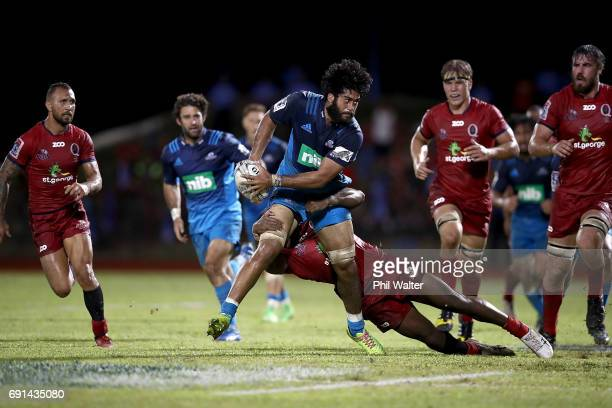 Akira Ioane of the Blues is tackled during the round 15 Super Rugby match between the Blues and the Reds at Apia Park National Stadium on June 2 2017...