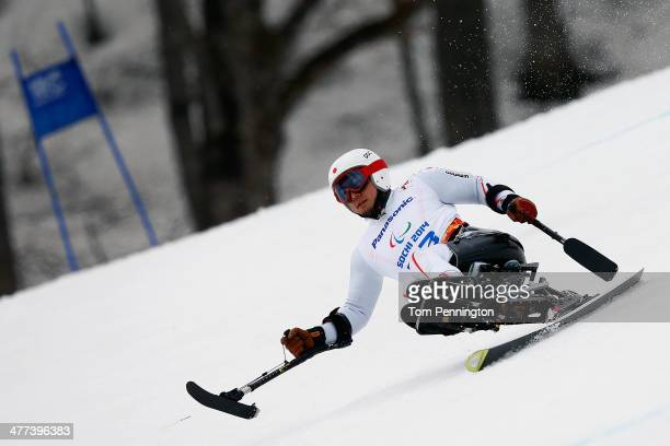Akira Kano of Japan competes in the Men's Super G sitting during day two of Sochi 2014 Paralympic Winter Games at Rosa Khutor Alpine Center on March...