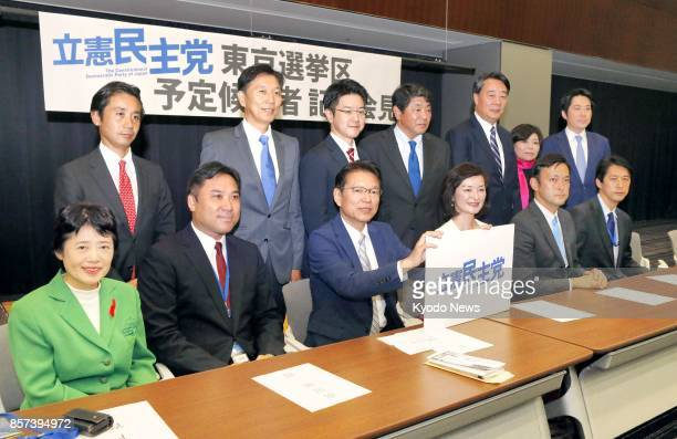 Akira Nagatsuma a member of the recently dissolved lower house attends a press conference in Tokyo on Oct 4 together with several candidates of the...