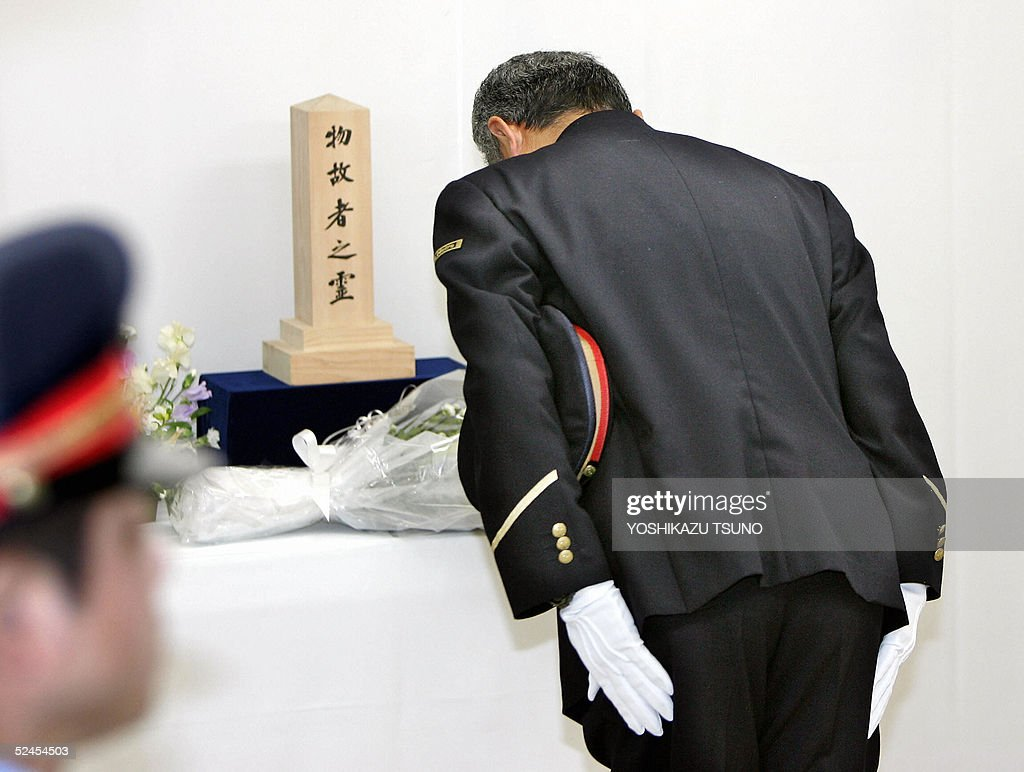 Akira Nishikawa, stationmaster of Kasumigaseki subway station bows his head deeply before an altar for the victims of Aum Supreme Truth sect's deadly Sarin gas attack in 1995, on its tenth anniversary 20 March 2005 at the Kasumigaseki station in Tokyo. Ten years after it released fatal nerve gas in the Tokyo subway, the Aum Supreme Truth doomsday cult remains a threat luring vulnerable people into dangerous rituals. AFP PHOTO/Yoshikazu TSUNO