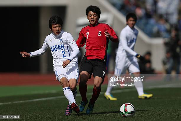 Akira Ogawa of High School XI and Ritsu Doan of U18 JLeague XI compete for the ball during the Next Generation Match between U18 JLeague XI and Japan...