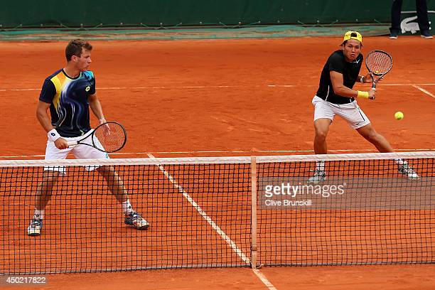 Akira Santillan of Australia and Lucas Miedler of Austria in action during the boys' doubles final match against Benjamin Bonzi and Quentin Halys of...