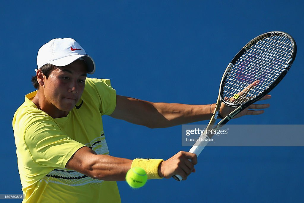 Akira Santillan of Australia plays a backhand in his first round doubles match with Marc Polmans of Australia against Hyeon Chung and Duk-Young Kim of Korea during the 2013 Australian Open Junior Championships at Melbourne Park on January 20, 2013 in Melbourne, Australia.