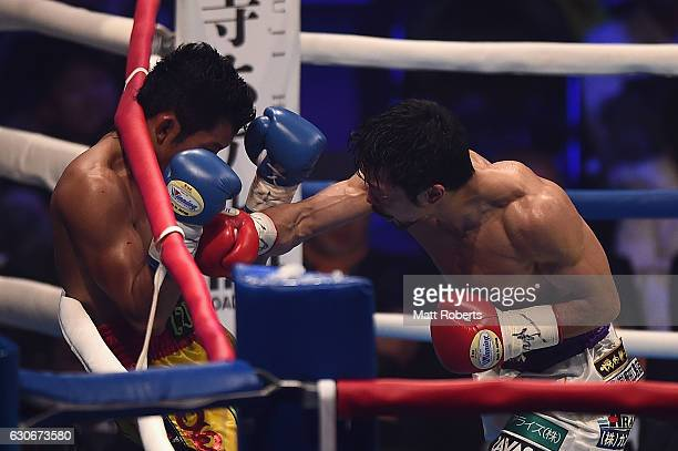 Akira Yaegashi punches Wittawas Basapean during the IBF World Light Flyweight Title bout between Akira Yaegashi of Japan and Wittawas Basapean of...
