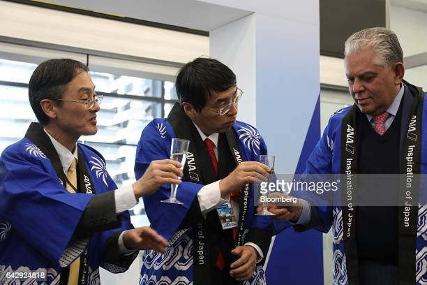 Akira Yamada Japan's ambassador to Mexico center and Hideshi Oshimo general manager of Mexico operations for All Nippon Airways Co left toast with...