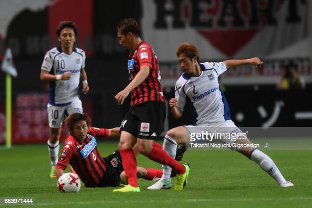 Akito Fukumori of Consadole Sapporo and Genta Miura of Gamba Osaka compete for the ball during the JLeague J1 match between Consadole Sapporo and...