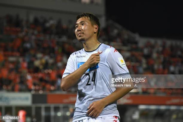 Akito Fukumori of Consadole Sapporo applauds supporters after the 22 draw in the JLeague J1 match between Omiya Ardija and Consadole Sapporo at NACK...