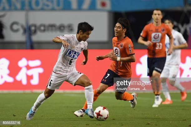 Akito Fukuta of Sagan Tosu and Ataru Esaka of Omiya Ardija compete for the ball during the JLeague J1 match between Sagan Tosu and Omiya Ardija at...