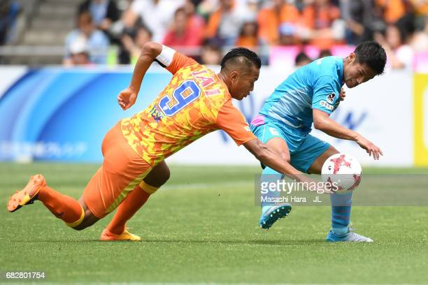 Akito Fukuta of Sagan Tosu and Chong Tese of Shimizu SPulse compete for the ball during the JLeague J1 match between Shimizu SPulse and Sagan Tosu at...